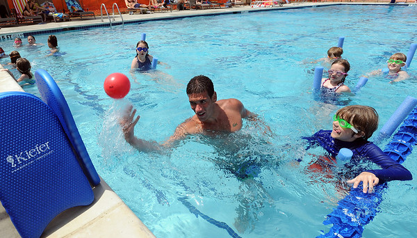"Swim teacher Dan Graham, flips up the ball during a game for his class on Wednesday.<br /> The new aquatics facility at the YMCA of Boulder Valley Arapahoe Center has its grand opening on June 12, in Lafayette.<br /> For a video and more photos, go to  <a href=""http://www.dailycamera.com"">http://www.dailycamera.com</a>.<br /> Cliff Grassmick / June 9, 2010"