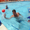 """Swim teacher Dan Graham, flips up the ball during a game for his class on Wednesday.<br /> The new aquatics facility at the YMCA of Boulder Valley Arapahoe Center has its grand opening on June 12, in Lafayette.<br /> For a video and more photos, go to  <a href=""""http://www.dailycamera.com"""">http://www.dailycamera.com</a>.<br /> Cliff Grassmick / June 9, 2010"""
