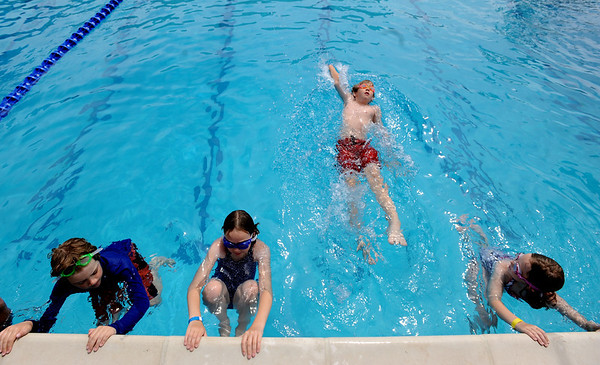 "John Lichens starts out using the backstroke while his brother Evan, left, and  Ella and Cassie Roberts wait for their turn during a swimming class.<br /> The new aquatics facility at the YMCA of Boulder Valley Arapahoe Center has its grand opening on June 12, in Lafayette.<br /> For a video and more photos, go to  <a href=""http://www.dailycamera.com"">http://www.dailycamera.com</a>.<br /> Cliff Grassmick / June 9, 2010"