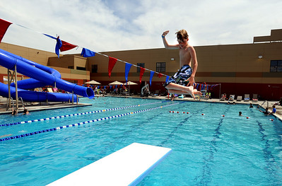 Jake Hermann twists off the board during free swim at the pool on Wednesday. The new aquatics facility at the YMCA of Boulder Valley Arapahoe Center has its grand opening on June 12, in Lafayette. For a video and more photos, go to www.dailycamera.com. Cliff Grassmick / June 9, 2010