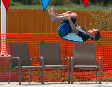Mason Walker does a roll off of the board, but there are no judges to see it. The new aquatics facility at the YMCA of Boulder Valley Arapahoe Center has its grand opening on June 12, in Lafayette. For a video and more photos, go to www.dailycamera.com. Cliff Grassmick / June 9, 2010