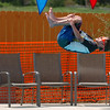 "Mason Walker does a roll off of the board, but there are no judges to see it.<br /> The new aquatics facility at the YMCA of Boulder Valley Arapahoe Center has its grand opening on June 12, in Lafayette.<br /> For a video and more photos, go to  <a href=""http://www.dailycamera.com"">http://www.dailycamera.com</a>.<br /> Cliff Grassmick / June 9, 2010"