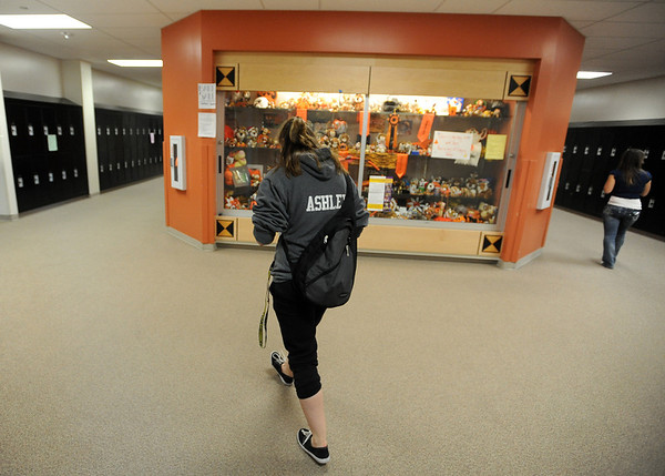 "Ashley Murphy walks to her second class of the day at Erie High School.<br /> Ashley Murphy, a senior at Erie High School, falls under the McKinney Vento Act for ""homeless"" students because she lives with her boyfriend's parents (living with someone who is not a legal guardian).<br /> For more photos and a video of Murphy, go to  <a href=""http://www.dailycamera.com"">http://www.dailycamera.com</a><br /> Cliff Grassmick / November 17, 2011"