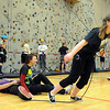 "Ashley Murphy pulls her friends, Kristina Bleeker, left, and Kaitlynne Pratt during climbing class.<br /> Ashley Murphy, a senior at Erie High School, falls under the McKinney Vento Act for ""homeless"" students because she lives with her boyfriend's parents (living with someone who is not a legal guardian).<br /> For more photos and a video of Murphy, go to  <a href=""http://www.dailycamera.com"">http://www.dailycamera.com</a><br /> Cliff Grassmick / November 17, 2011"