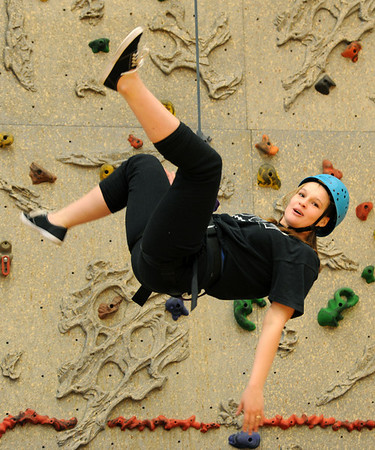 "Ashley Murphy has some fun after finishing her climb in class.<br /> Ashley Murphy, a senior at Erie High School, falls under the McKinney Vento Act for ""homeless"" students because she lives with her boyfriend's parents (living with someone who is not a legal guardian).<br /> For more photos and a video of Murphy, go to  <a href=""http://www.dailycamera.com"">http://www.dailycamera.com</a><br /> Cliff Grassmick / November 17, 2011"