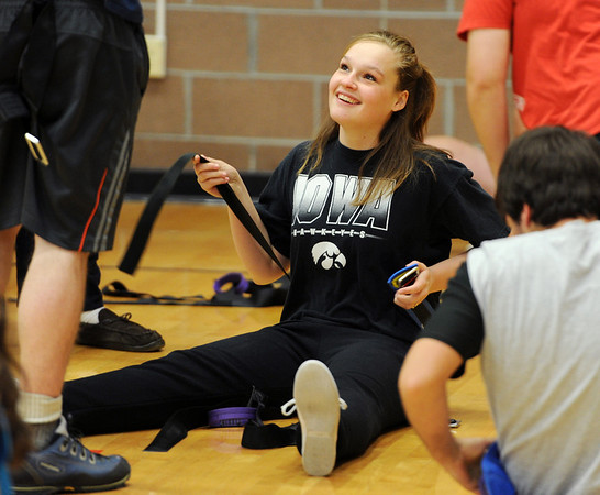 "Ashley Murphy talks to her friends while getting ready for the climbing class.<br /> Ashley Murphy, a senior at Erie High School, falls under the McKinney Vento Act for ""homeless"" students because she lives with her boyfriend's parents (living with someone who is not a legal guardian).<br /> For more photos and a video of Murphy, go to  <a href=""http://www.dailycamera.com"">http://www.dailycamera.com</a><br /> Cliff Grassmick / November 17, 2011"