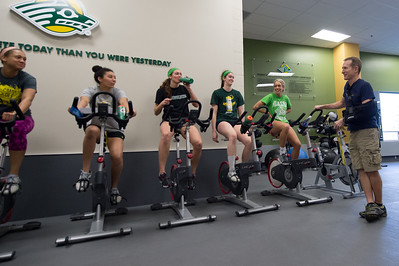 Volleyball Head Coach Chris Green talks with his players as they cool down on the stationary bikes after weight training on April 10.  seawolvesintheoffseason_39_18538247374_o.jpg