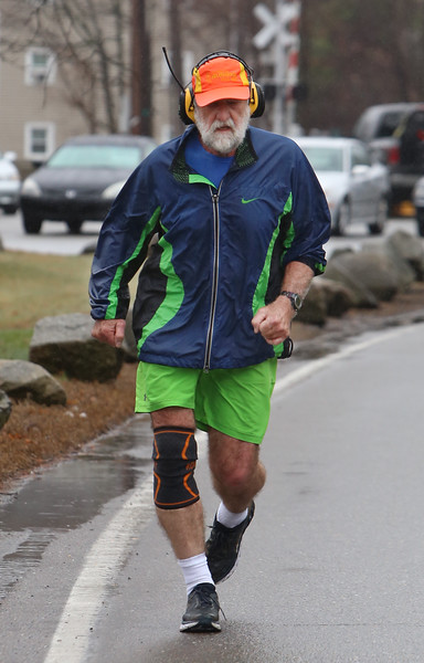 Jogger in Ayer, who did not want to stop.  (SUN/Julia Malakie)