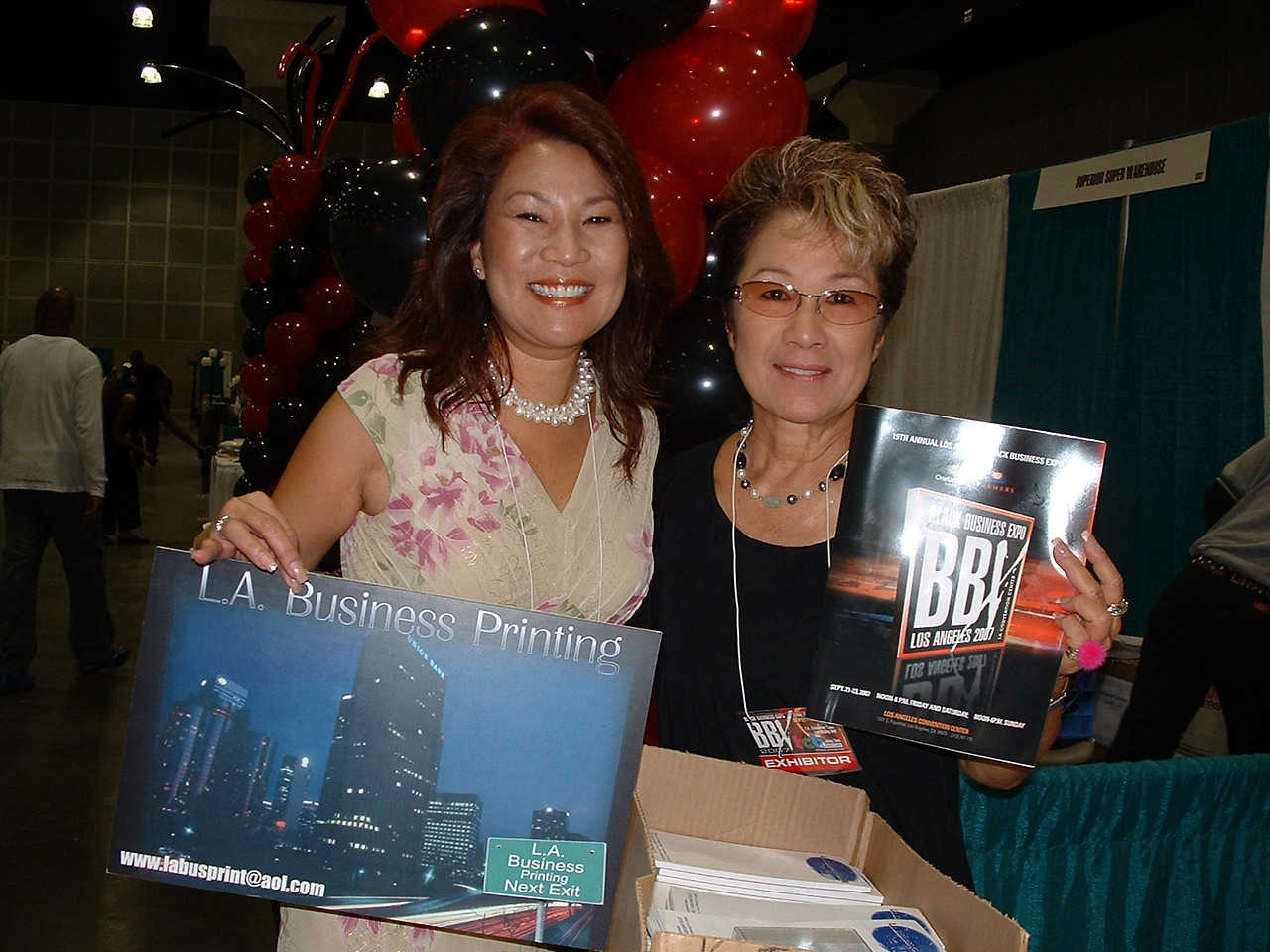 L.A. Business Printing printed the Expo Program Guide...Here, Office Manager Charlene and her sister pose with Eric Johnson's (owner) handiwork.