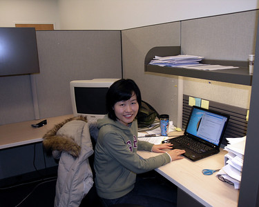 "Ms. Hee Jin Jun working at the computer in the BSCR facility (""the aquarium"")."