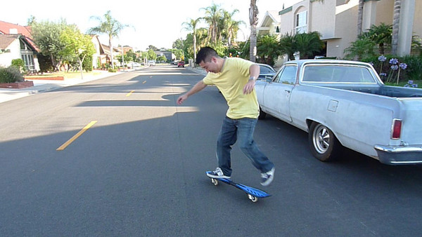 Scott riding a surf skate board