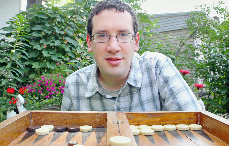 Frank Raposa with his backgammon game at his home in Fitchburg. SENTINEL & ENTERPRISE/JOHN LOVE