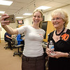 Fellow FATV show host Sam Squailia snaps a selfie with Barbara Foster in the studio ahead of the taping of her 40th anniversary show 'Barbara & You' on FATV on Tuesday evening. SENTINEL & ENTERPRISE / Ashley Green