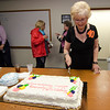 Barbara Foster cuts a cake following the taping of her 40th anniversary episode of Barbara & You, her show on Fitchburg Access Television. SENTINEL & ENTERPRISE / Ashley Green