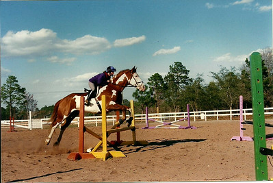 Karen jumping Poncho