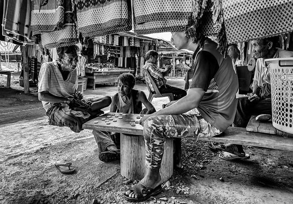 Men in a Long Neck Karen Village waiting for tourists