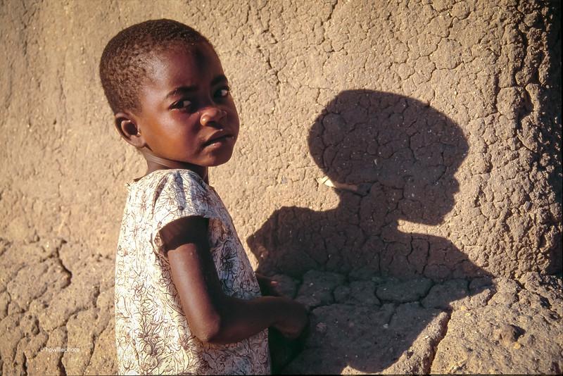 Schoolgirl and her shadow.
