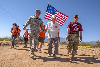 "Followed by ""Ben's Brigade,"" our friend Ben Skardon on his 8.4-mile march - from a newspaper photo."