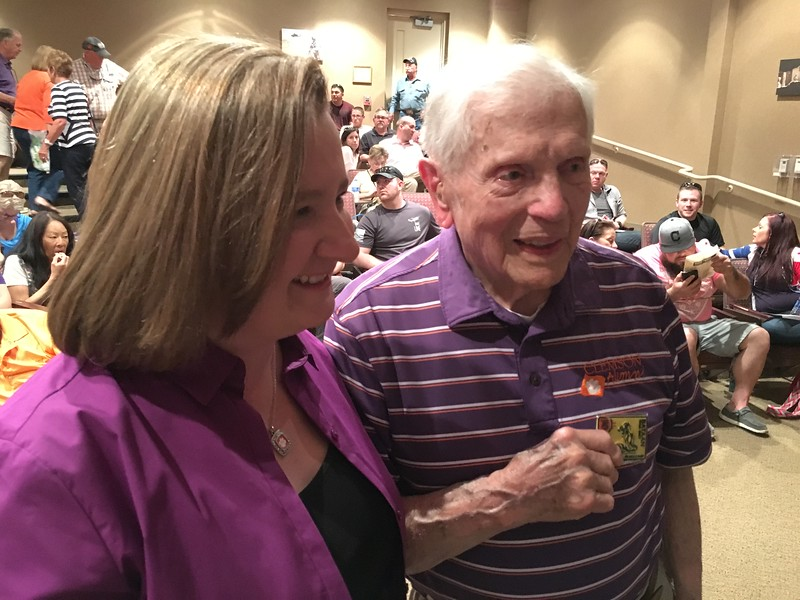 That's Ben Skardon, a survivor, with his granddaughter....In July he'll turn 100. .. Check link below: