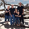 Family portrait on the beach in Jacksonville, Florida by John Shippee Photography.