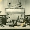 """An advertisement photo """"Lion of the Week"""" the Detroit Lions, with a center photo of Dudley surrounded by a show display for R. H. Fyfe & Co., 1947 (02673)"""