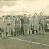 Close up group photo of Bill Dudley and others standing in front of automobiles (02677)