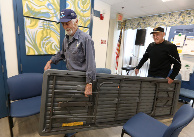 Billerica Senior Center volunteers Art Collier, 88, left, and Joe Duggan, 82, both of Billerica, set up the tables and chairs for weekly Bingo at the Senior Center.  (SUN/Julia Malakie)