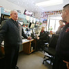 Billerica fire chief Thomas Conway at Fire Dept HQ, left, with fire alarm operators Diane Deloge and John Pellegrino, rear, and firefighter James Elder, right. Conway is retiring in January. (SUN/Julia Malakie)