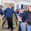 Billerica firefighters install a wheelchair ramp for Talbot Ave resident Chris Clark, 34, who has multiple sclerosis and uses a walker. Firefighters Chuck Rivanis and Shawn O'Connor at left, Bill Paskiewicz and Luke Riberio at right.  (SUN/Julia Malakie)