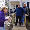 Billerica firefighters install a wheelchair ramp for Talbot Ave resident Chris Clark, 34, who has multiple sclerosis and uses a walker. Chris Clark with his parents Cindy and Ted Clark, and their dog Lucy. (SUN/Julia Malakie)