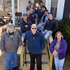 Billerica firefighters install a wheelchair ramp for Talbot Ave resident Chris Clark, 34, who has multiple sclerosis and uses a walker. Clark with his parents Ted and Cindy Clark, and firefighters, clockwise from left: Joe Keane, dispatcher John Pellegrino, Bill Paskiewicz, Shawn O'Connor, Brett Fredrickson, Rich Gutierrez, Dave Forziati, Chuck Rivanis, Chuck McDevitt and Luke Ribeiro. Missing from photo: Matthew Battcock. (SUN/Julia Malakie)