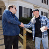 Billerica firefighters install a wheelchair ramp for Talbot Ave resident Chris Clark, 34, who has multiple sclerosis and uses a walker. Clark thanks firefighter Chuck McDevitt as firefighters leave. (SUN/Julia Malakie)