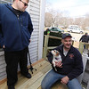 Billerica firefighters install a wheelchair ramp for Talbot Ave resident Chris Clark, 34, who has multiple sclerosis and uses a walker. Chris Clark and firefighter Joe Keane, who wanted to meet the family dog, Lucy.  (SUN/Julia Malakie)