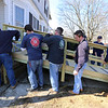 Billerica firefighters install a wheelchair ramp for Talbot Ave resident Chris Clark, 34, who has multiple sclerosis and uses a walker.  (SUN/Julia Malakie)