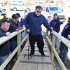 Billerica firefighters install a wheelchair ramp for Talbot Ave resident Chris Clark, 34, who has multiple sclerosis and uses a walker. Chris Clark tries out the ramp. Watching from left, Matthew Battcock, Rich Gutierrez, Chuck Rivanis and Shawn O'Connor. (SUN/Julia Malakie)