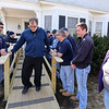Billerica firefighters install a wheelchair ramp for Talbot Ave resident Chris Clark, 34, who has multiple sclerosis and uses a walker. Firefighter Chuck Rivanis at left, Luke Riberio and Clark's mother Cindy Clark at right.  (SUN/Julia Malakie)