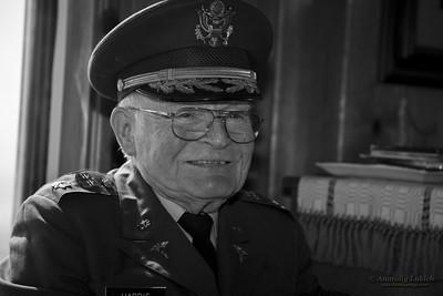 Elderly US Veteran in military uniform.