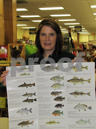 """Erin Ford with the Webster County DNR handed out informational brochures and pins at the book talk/signing of """"Gone Fishing"""" by Tamera Will Wissinger."""