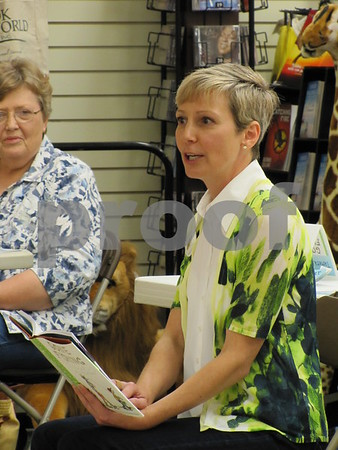 """Author, Tamera Will Wissinger, reads her book """"Gone Fishing"""" aloud to the audience at Book World in the Crossroads Mall in Fort Dodge.  The author was holding a book signing at the book store on Saturday afternoon."""