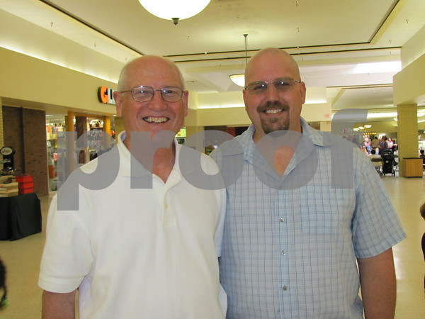 Clayton Will and Chris Will, father and brother of the author Tamera Will Wissinger, at the book signing held at Crossroads Mall Book World.