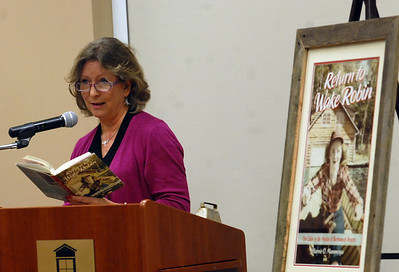 "Marnie O Mamminga reads part of her book ""Return to Wake Robin"" at the Batavia Library during the program Book Between Bites Thursday Dec. 20, 2012. Erica Benson—ebenson@shawmedia.com"