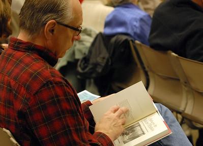 "Art Blodgett of Batavia looks over Marnie O Mamminga's book ""Return to Wake Robin"" at the Batavia Library during the program Book Between Bites Thursday Dec. 20, 2012. Erica Benson—ebenson@shawmedia.com"