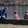 People enjoy walking along the Merrimack River Wednesday afternoon. Christian Ayala of Lowell and daughter Margot, 5, and son Jackson, 11, watch the birds on the river.  (SUN/Julia Malakie)