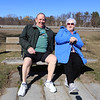 "People enjoy walking along the Merrimack River Wednesday afternoon. Richard Nocera of Dracut and his wife Cheryl Nocera, who leaned away and said ""we're not six feet apart!""  They said ""this is like going on a vacation. We maybe sneak to the market. We've just been playing it safe."" (SUN/Julia Malakie)"