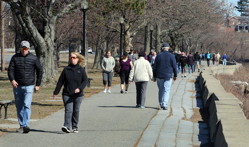 Lots of people take advantage of good weather Wednesday afternoon to walk on Vandenberg Esplanade along the Merrimack River. (SUN/Julia Malakie)
