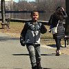 "People enjoy walking along the Merrimack River Wednesday afternoon. Benjamin Forbes, 6, of Tewksbury does some rollerblading at Vandenberg Esplanade. He' in 1st grade and said ""I miss school a little bit. I like going on the bus."" (SUN/Julia Malakie)"