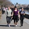 "Lots of people take advantage of good weather Wednesday afternoon to walk on Vandenberg Esplanade along the Merrimack River. From left, Nora Lopez, her daughter Yomaira Lopez, and granddaughter Alexandra Mejia Lopez, 12, all of Lowell. About school, Alexandra, a 6th grader at St. Louis School, said ""I'm missing my friends"" but ""they send us assignments."" (SUN/Julia Malakie)"
