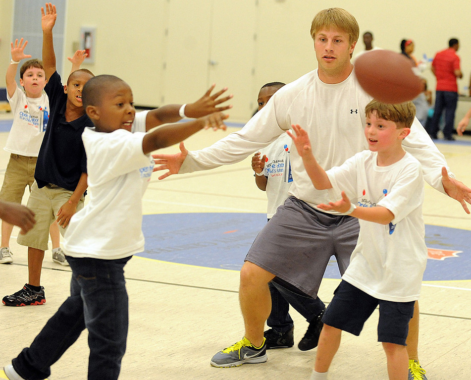 Willy Korn has some fun with the guys. <br /> The Kroc Center celebrated the 2012 National Boys & Girls Club Week with a Family Fun Night.<br /> GWINN DAVIS PHOTOS<br /> gwinndavis@gmail.com  <br /> (864) 915-0411