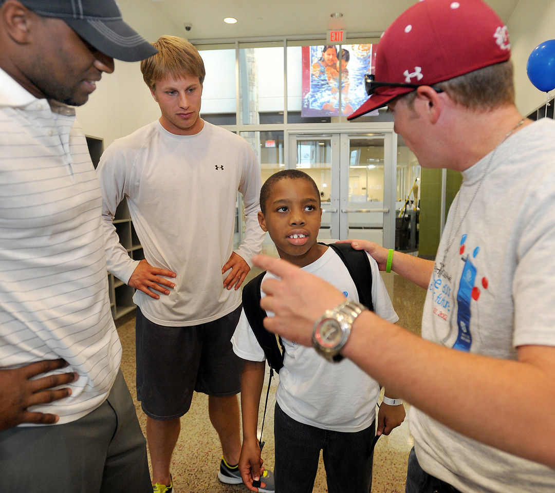 Football standouts Brian Bratton, left, Willy Korn and Chase Bowlin greet the guests. More photos and information coming.<br /> The Kroc Center celebrated the 2012 National Boys & Girls Club Week with a Family Fun Night.<br /> GWINN DAVIS PHOTOS<br /> gwinndavis@gmail.com  <br /> (864) 915-0411