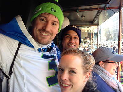 Brian, Amyn and Jen watching the Seahawks victory parade, February 2014